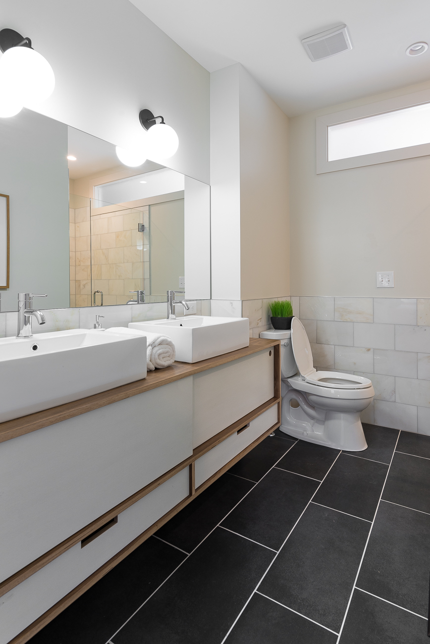 The third floor bedroom overlooks Main Street and has its own private master bathroom with a double vanity sink. 1428 Main Street is listed for $489,000 by Michael Chewning and Seth Maney with Coldwell Banker West Shell. / Image: Phil Armstrong, Cincinnati Refined // Published: 2.17.19