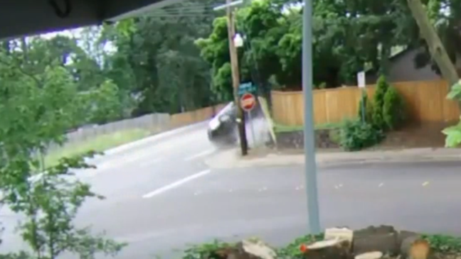VIDEO: Woman cited for careless driving while holding phone, crashing into pole