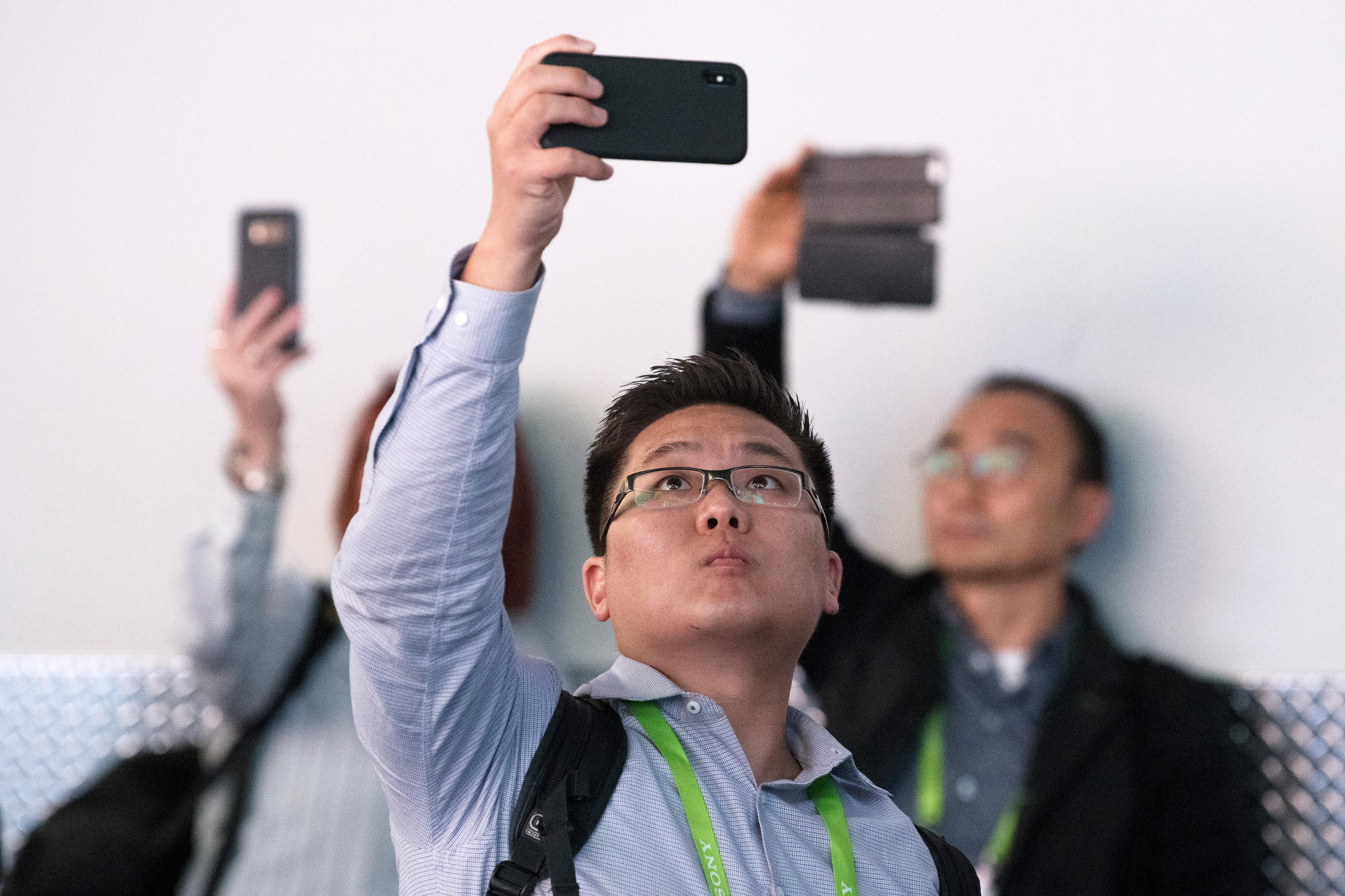 Attendees use their phones to record video during the second day of CES Wednesday, January 10, 2018, at the Las Vegas Convention Center. CREDIT: Sam Morris/Las Vegas News Bureau