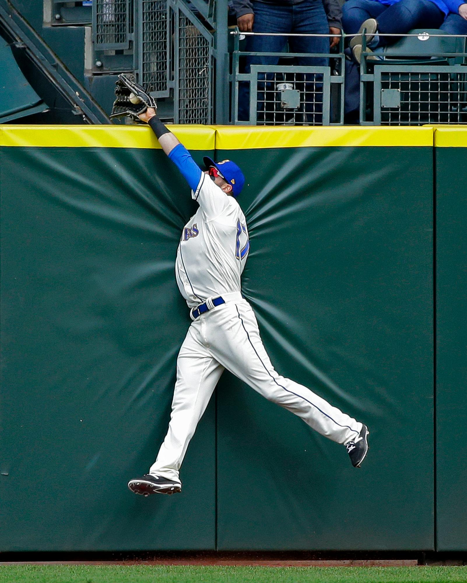 Seattle Mariners center fielder Mitch Haniger makes a leaping catch at the wall to rob Texas Rangers' Joey Gallo of a two-run home run with the score tied in the eighth inning of a baseball game, Sunday, April 16, 2017, in Seattle. (AP Photo/Ted S. Warren)