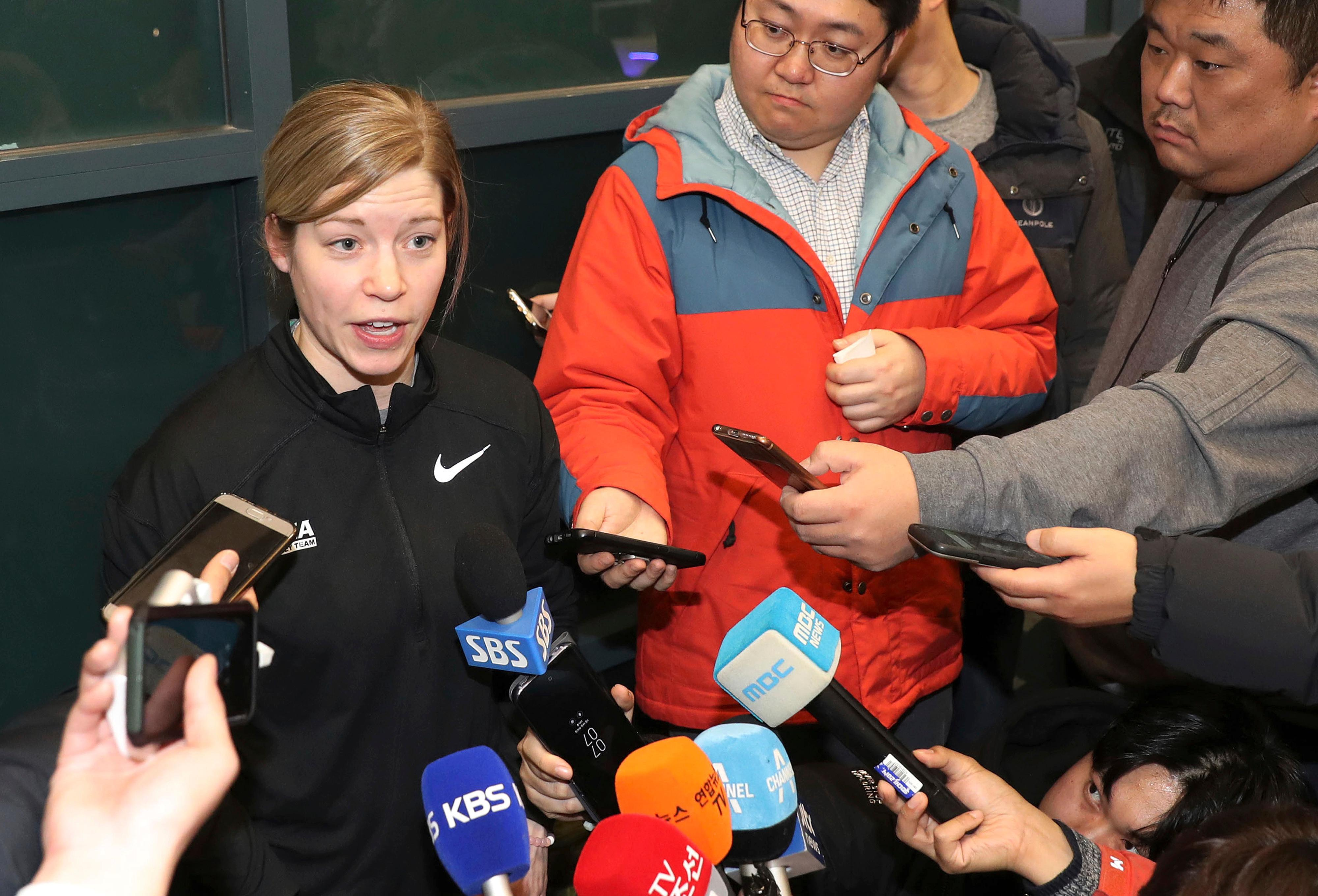 "In this Tuesday, Jan. 16, 2018, photo, South Korean women's hockey team head coach Sarah Murray speaks as she returns from the team's U.S. training camp, at Incehon International Airport in Incheon, South Korea. There is growing concern in South Korea that a proposal to form a joint women's hockey team with North Korea for the Olympics could be bad for the South Korean players. ""Adding somebody so close to the Olympics is a little bit dangerous just for team chemistry because the girls have been together for so long,"" she said. (Ha Sa-hun/Yonhap via AP)"