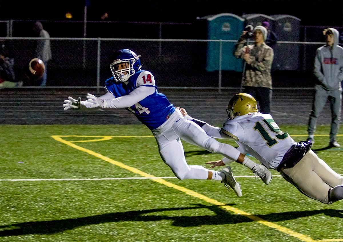 The Lancers' Myles Green-Richards (#14) misses a catch in the end zone. The Churchill Lancers defeated the Pendleton Buckaroos 42-15, in the first round of the state 5A playoffs. Photo by August Frank, Oregon News Lab