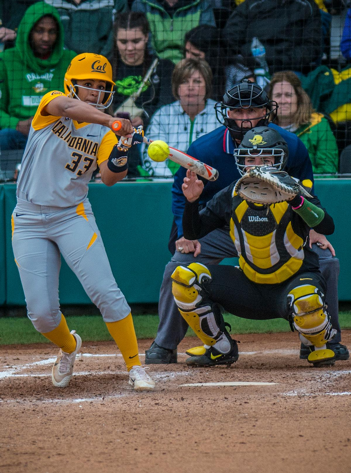 Cal Bears Khala Taylor (#33) swings at the ball. The Oregon Ducks defeated the Cal Bears 2-1 in game two of a three-game series. Photo by Rhianna Gelhart, Oregon News Lab