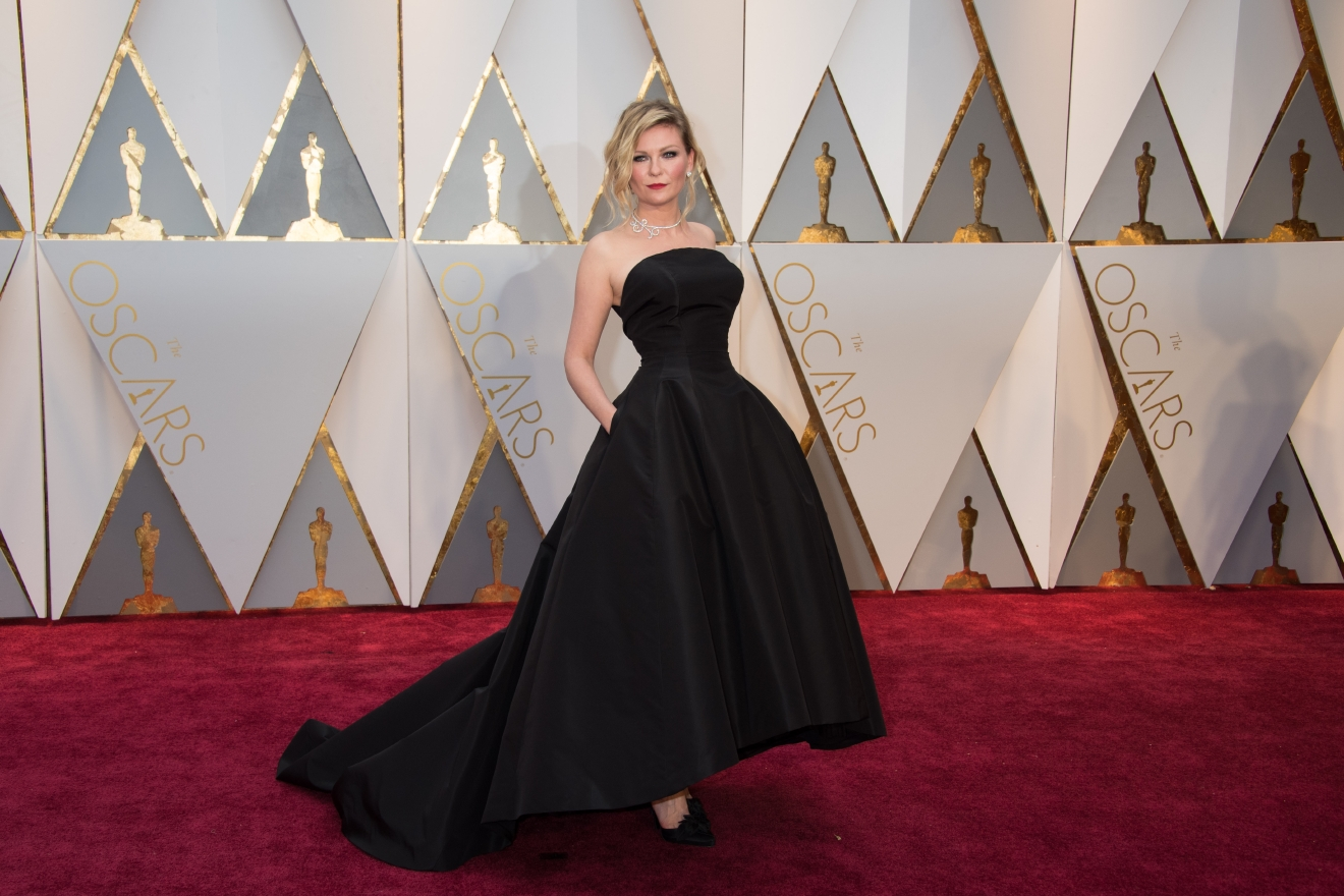 #3: Kirsten Dunst. This is how you stay simple, stay classic, and stay perfect. The silhouette, the color, it's very Audrey and we love it. (Image: AMPAS)