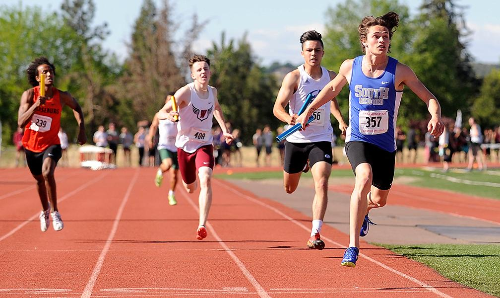 Andy Atkinson / Mail TribuneSouth Medford's Austin Boster (357) crosses the finish line anchoring and winning the 4X400 meter relay at the SWC Championship Meet at North Medford High School Saturday.