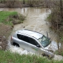 SUV plunges into creek in Alexander; driver rescued