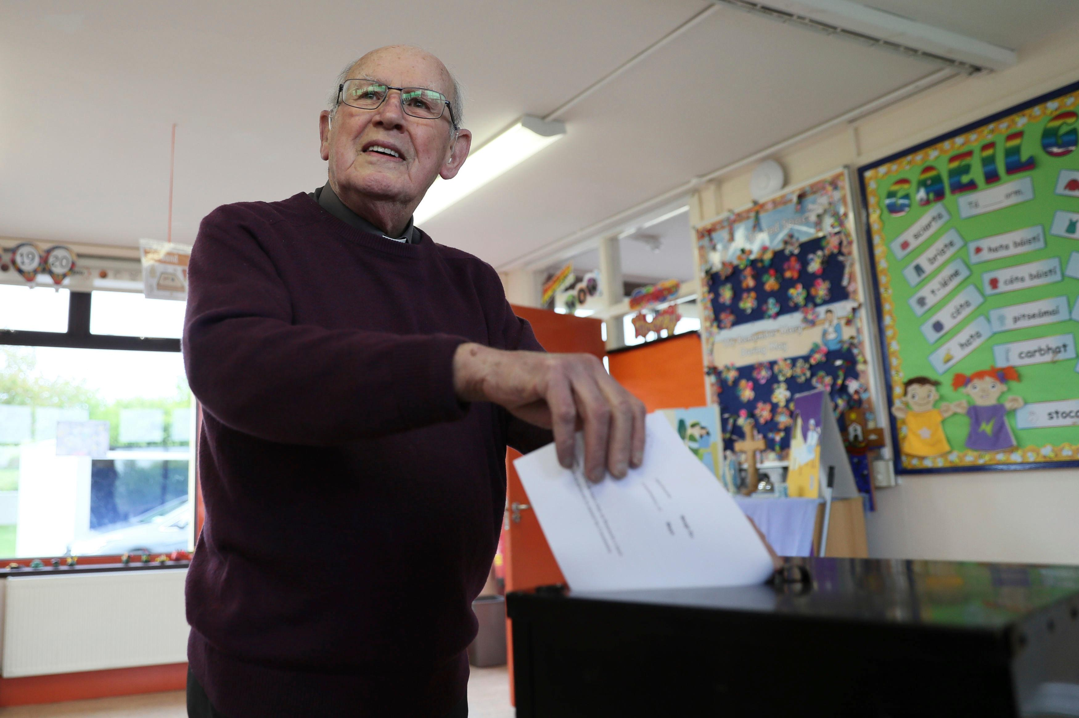 Father McDonagh casts his ballot for the referendum on the 8th Amendment of the Irish Constitution, in Mayo, Ireland, Friday May 25, 2018. The referendum on whether to repeal the country's strict anti-abortion law is being seen by anti-abortion activists as a last-ditch stand against what they view as a European norm of abortion-on-demand, while for pro-abortion rights advocates, it is a fundamental moment for declaring an Irish woman's right to choose. (Brian Lawless/PA via AP)