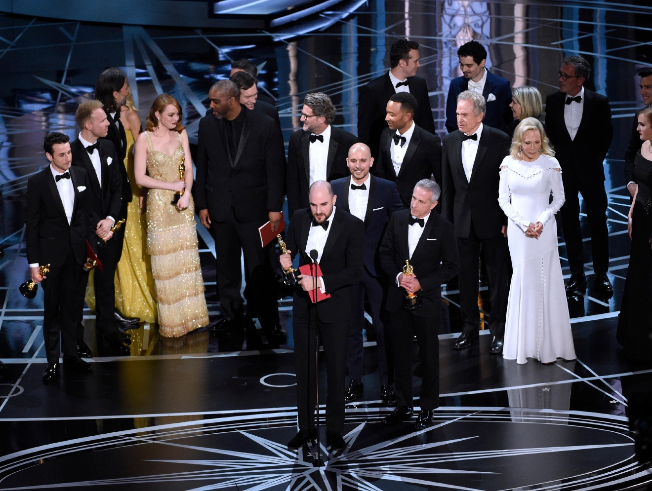"Jordan Horowitz, foreground center, and the cast of ""La La Land"" mistakenly accept the award for best picture at the Oscars on Sunday, Feb. 26, 2017, at the Dolby Theatre in Los Angeles. It was later announced that ""Moonlight,"" was the winner for best picture. (Photo by Chris Pizzello/Invision/AP)"
