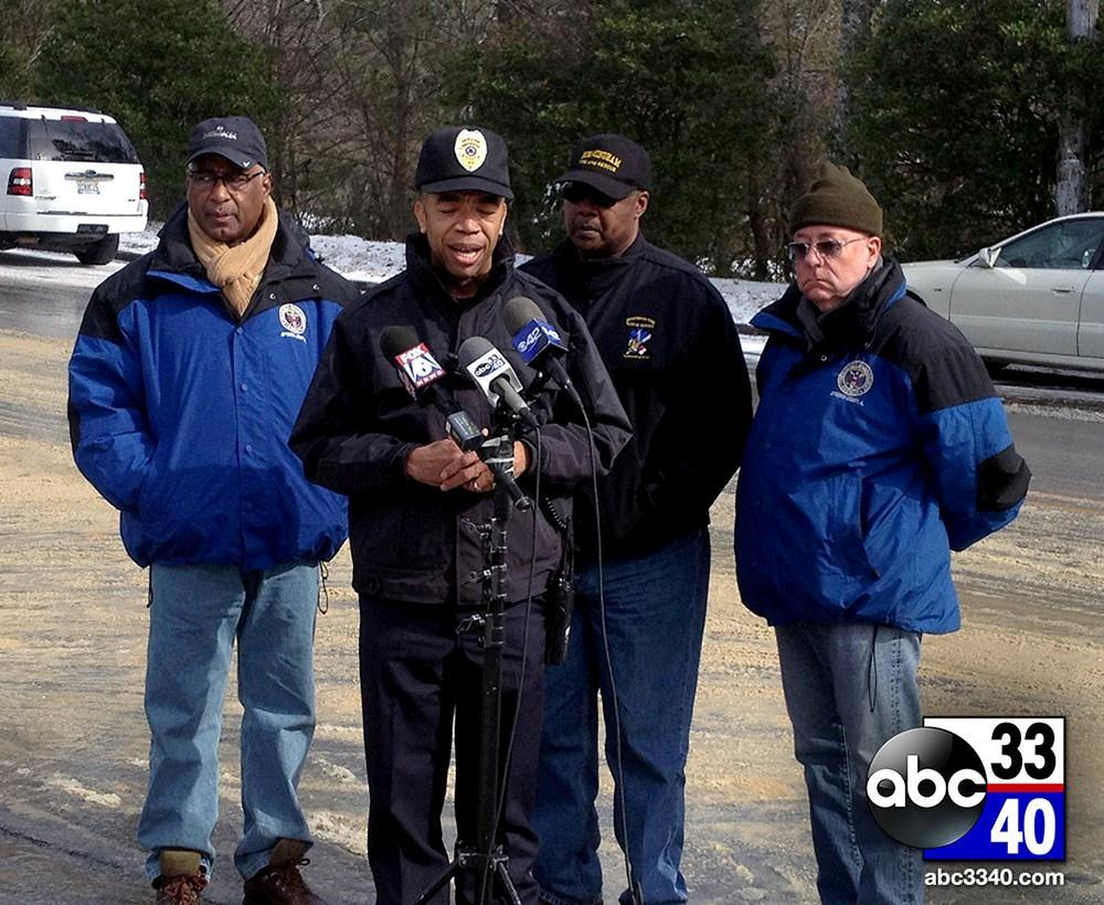 Birmingham city officials, including Mayor William Bell and Birmingham Police Chief A.C. Roper, update the media on the weather conditions at a news conference, Wednesday, January 29, 2014.