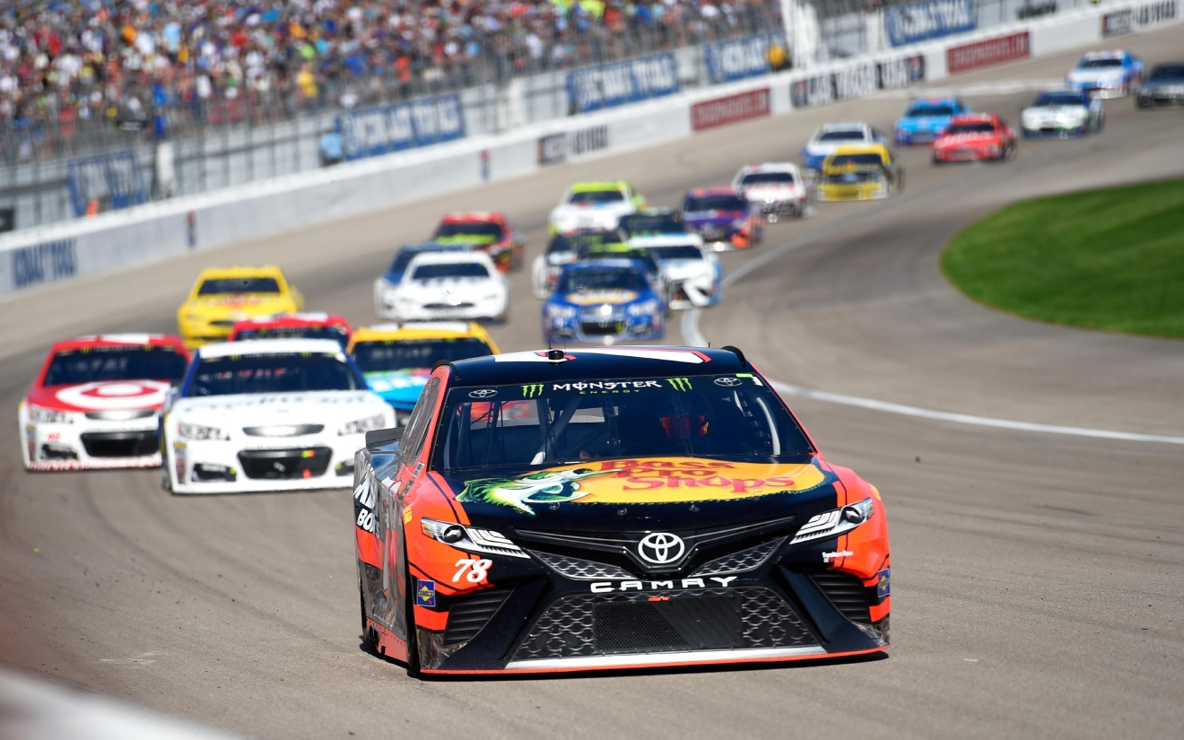 Martin Truex Jr. leads the field into turn one during the Monster Energy NASCAR Cup Series Kobalt 400 Sunday, March 12, 2017, at the Las Vegas Motor Speedway. (Sam Morris/Las Vegas News Bureau)