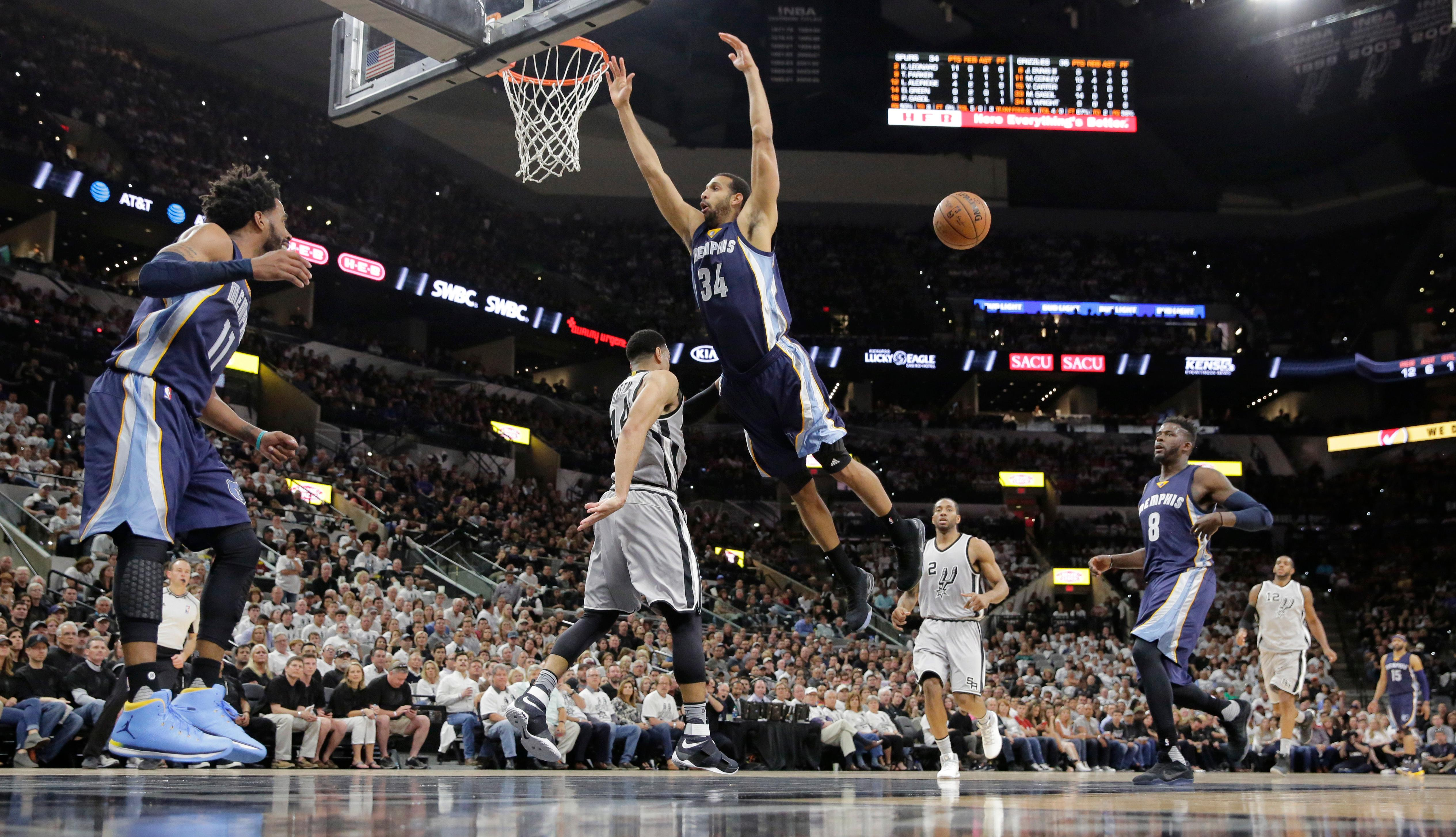 Memphis Grizzlies forward Brandan Wright (34) is stripped of the ball by San Antonio Spurs guard Danny Green (14) as he tries to score during the first half of Game 1 in a first-round NBA basketball playoff series, Saturday, April 15, 2017, in San Antonio. (AP Photo/Eric Gay)