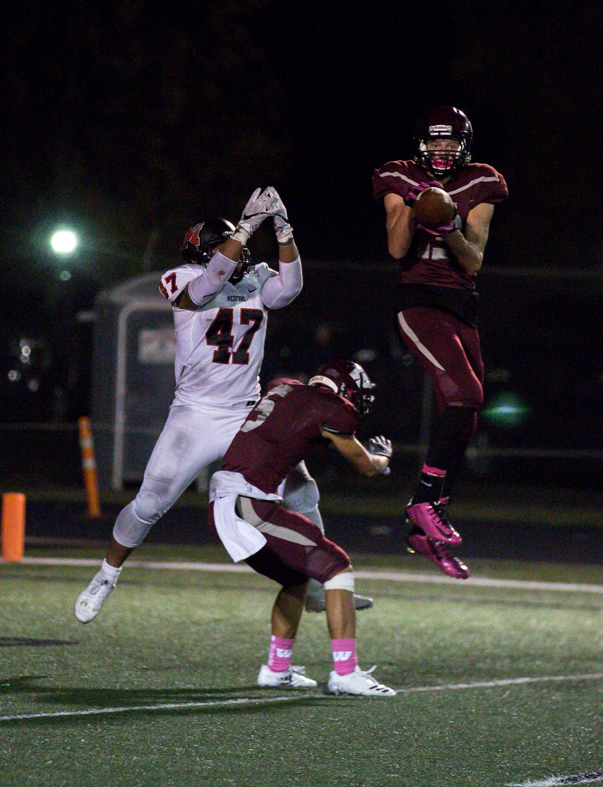 Willamette's Bryce Goggin (#13) intercepts a pass meant for North Medford's Isaac Manuel in North Medford's end zone. The North Medford Black Tornado defeated the Willamette Wolverines 45 – 19 on Friday, October 27, at Willamette High School, concluding the season for both teams. Photo by Kit MacAvoy, Oregon News Lab