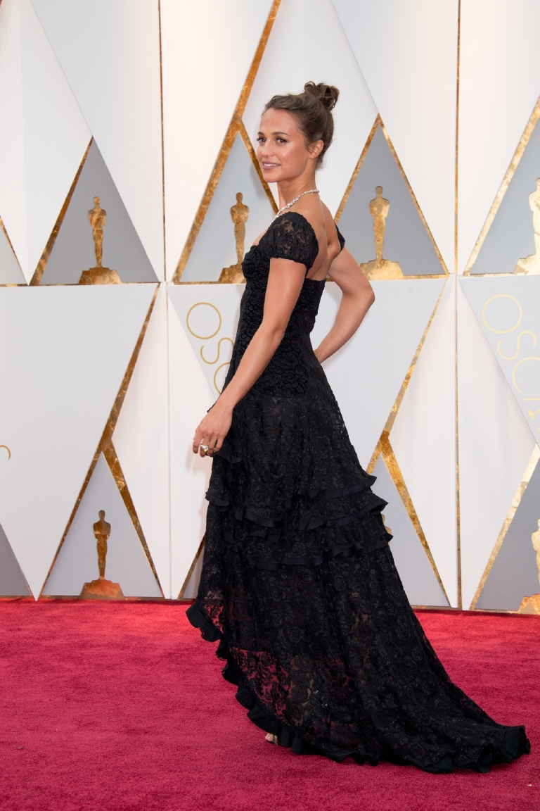 Oscars® presenter Alicia Vikander arrives on the red carpet at The 89th Oscars® at the Dolby® Theatre in Hollywood, CA on Sunday, February 26, 2017. (©A.M.P.A.S.)