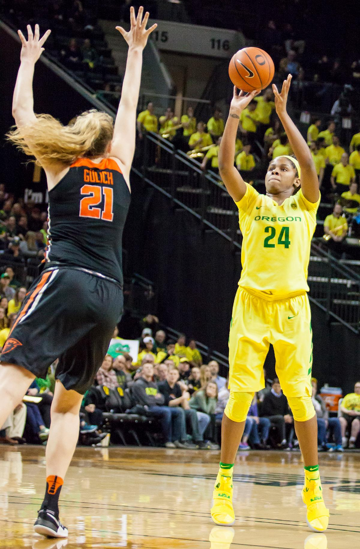 Oregon forward Ruthy Hebard (#24) shoots over Oregon State center Marie Gulich (#21). The Oregon Ducks lost 40 to 43 against the Oregon State Beavers after a tightly matched 4th quarter. Photo by Ben Lonergan, Oregon News Lab
