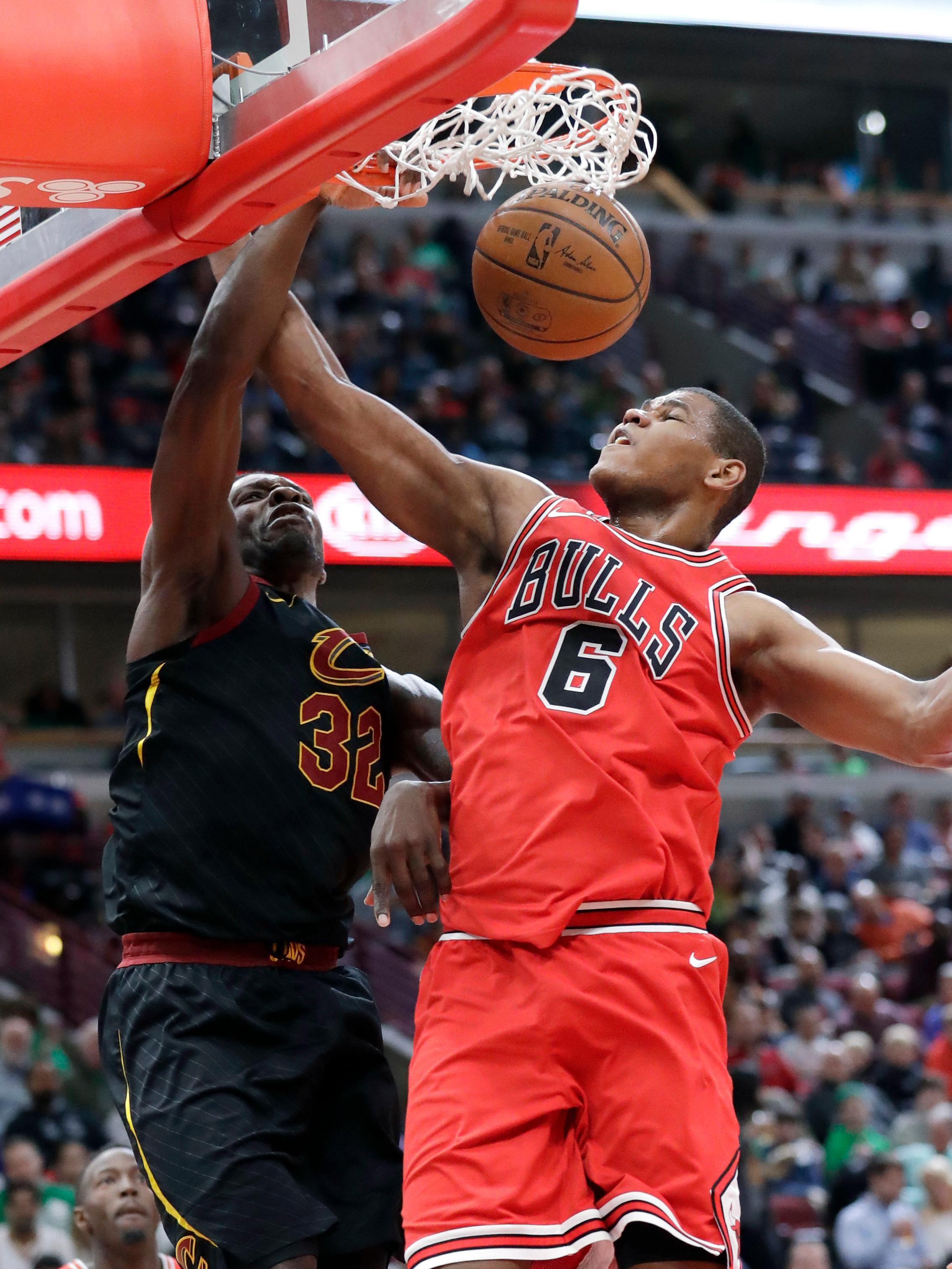 Cleveland Cavaliers forward Jeff Green, left, scores against Chicago Bulls center Cristiano Felicio during the first half of an NBA basketball game Saturday, March 17, 2018, in Chicago. (AP Photo/Nam Y. Huh)