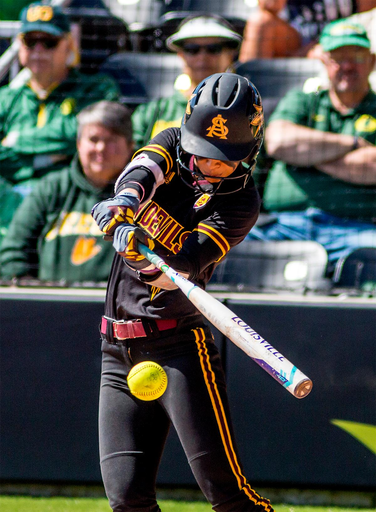 The Sun Devils' Taylor Becerra (#26) swings for the ball. The Oregon Ducks Softball team took their third win over the Arizona Sun Devils, 1-0, in the final game of the weekends series that saw the game go into an eighth inning before the Duck?s Mia Camuso (#7) scored a hit allowing teammate Haley Cruse (#26) to run into home plate for a point. The Ducks are now 33-0 this season and will next play a double header against Portland State on Tuesday, April 4 at Jane Sanders Stadium. Photo by August Frank, Oregon News Lab