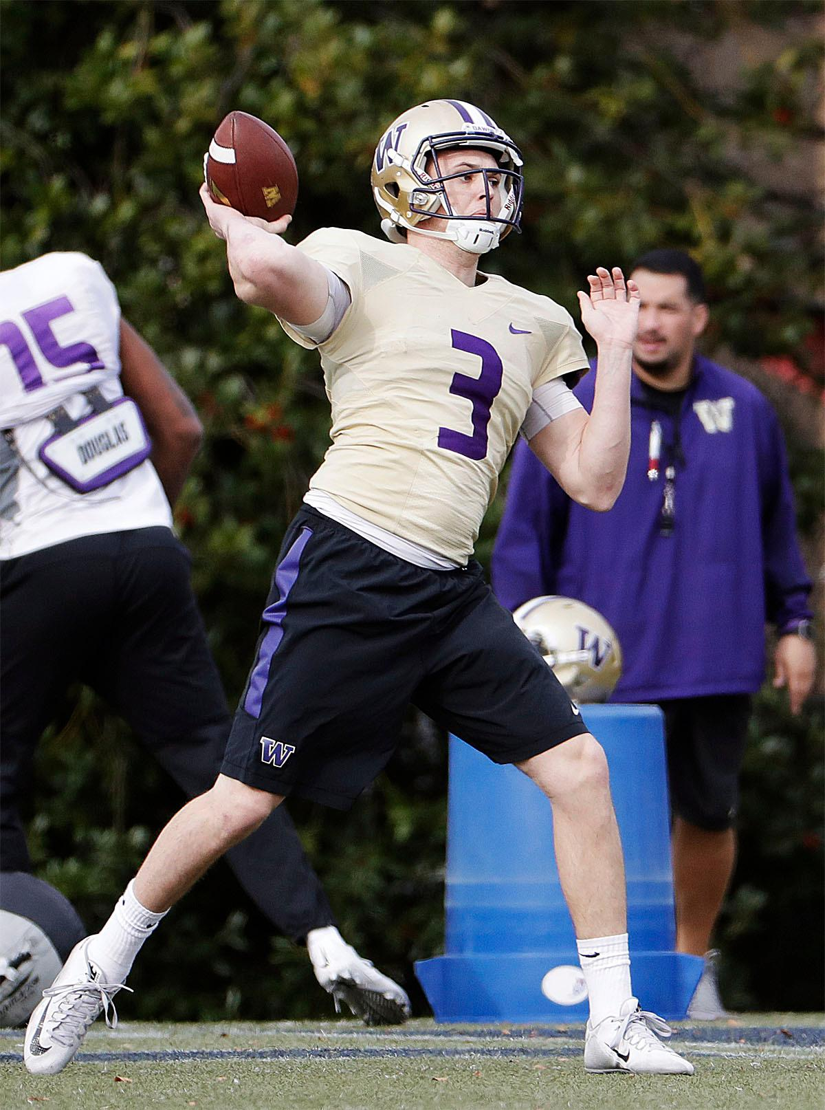 Washington quarterback Jake Browning throws a pass during a Peach Bowl NCAA college football practice in Atlanta, Wednesday, Dec. 28, 2016. Alabama and Washington will face off in the Peach Bowl football game Saturday. (AP Photo/David Goldman)