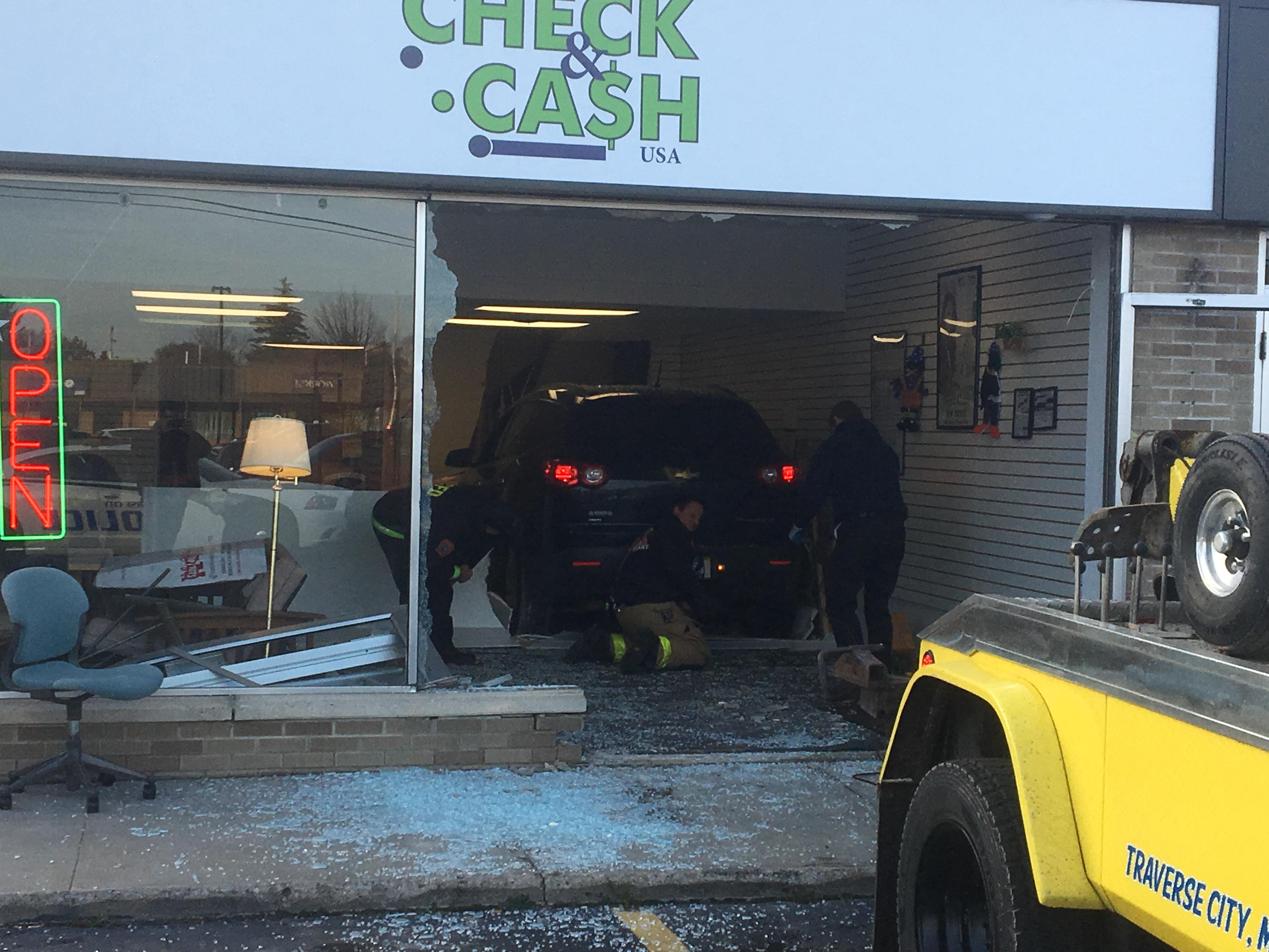Police are at the scene of a vehicle that crashed into a Traverse City business. It happened around 3:30 p.m. Monday at the Check & Cash on South Garfield and Baldwin.