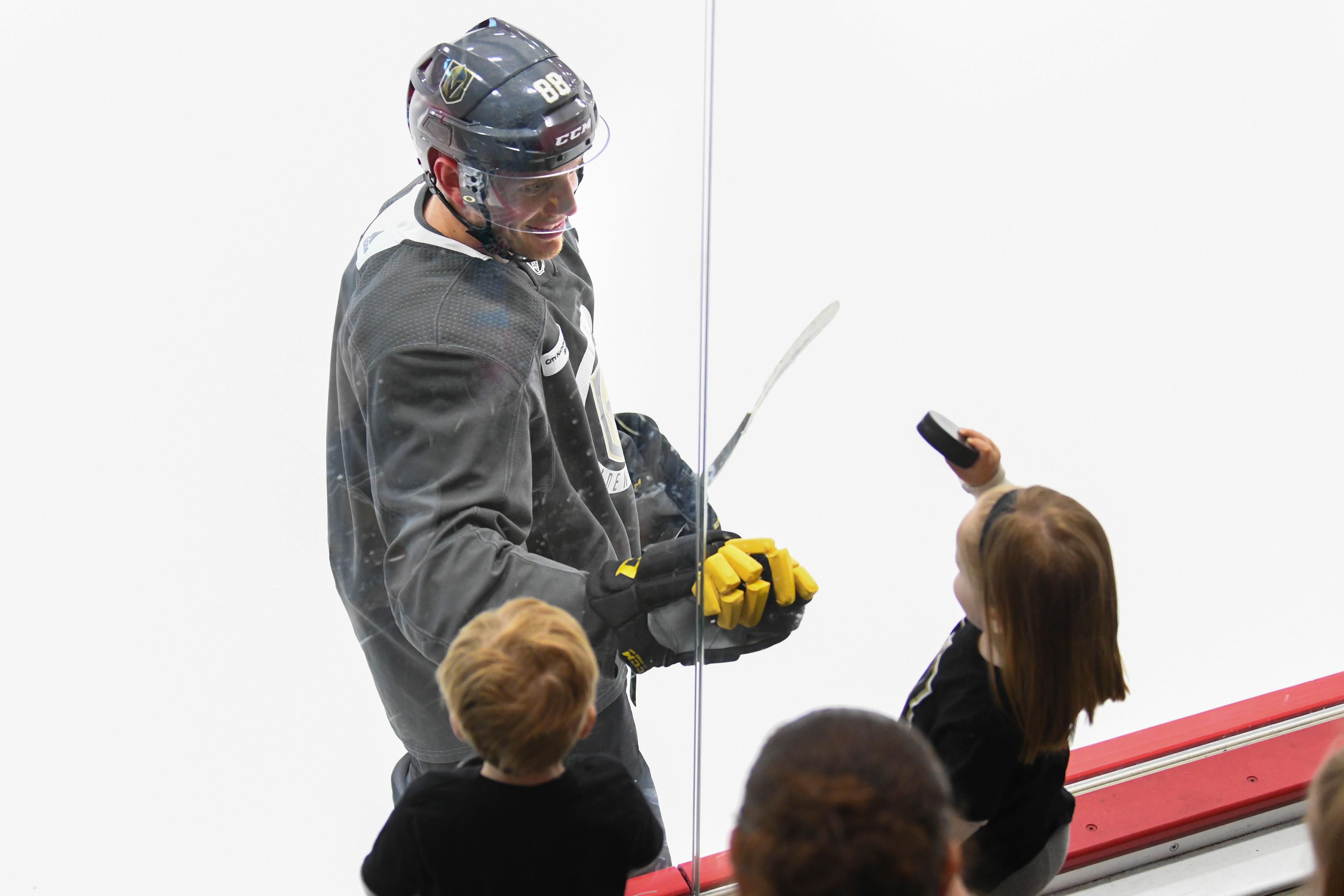 Vegas Golden Knights defenseman Nate Schmidt (88) taps the glass for Carson and Camille Wirick during the Golden Knights practice Friday, April 20, 2018, at City National Arena in Las Vegas. CREDIT: Sam Morris/Las Vegas News Bureau