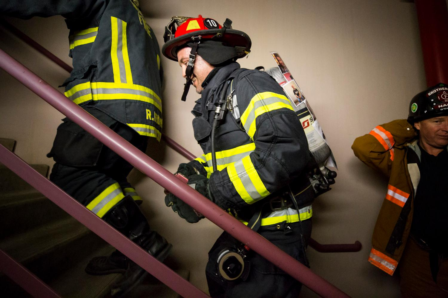 AJ from Warm 106.9 climbs up the 69 floors of the Columbia Tower during a training climb foor the Scott Firefighter Stairclimb on Friday, March 9, 2018. 2,000 firefighters are expected the 69 floors (1,356 stairs!) on Sunday for the Scott Firefighter Stairclimb to benefit the Leukemia & Lymphoma Society. To donate to this cause, please visit www.firefighterstairclimb.org. (Sy Bean / Seattle Refined)