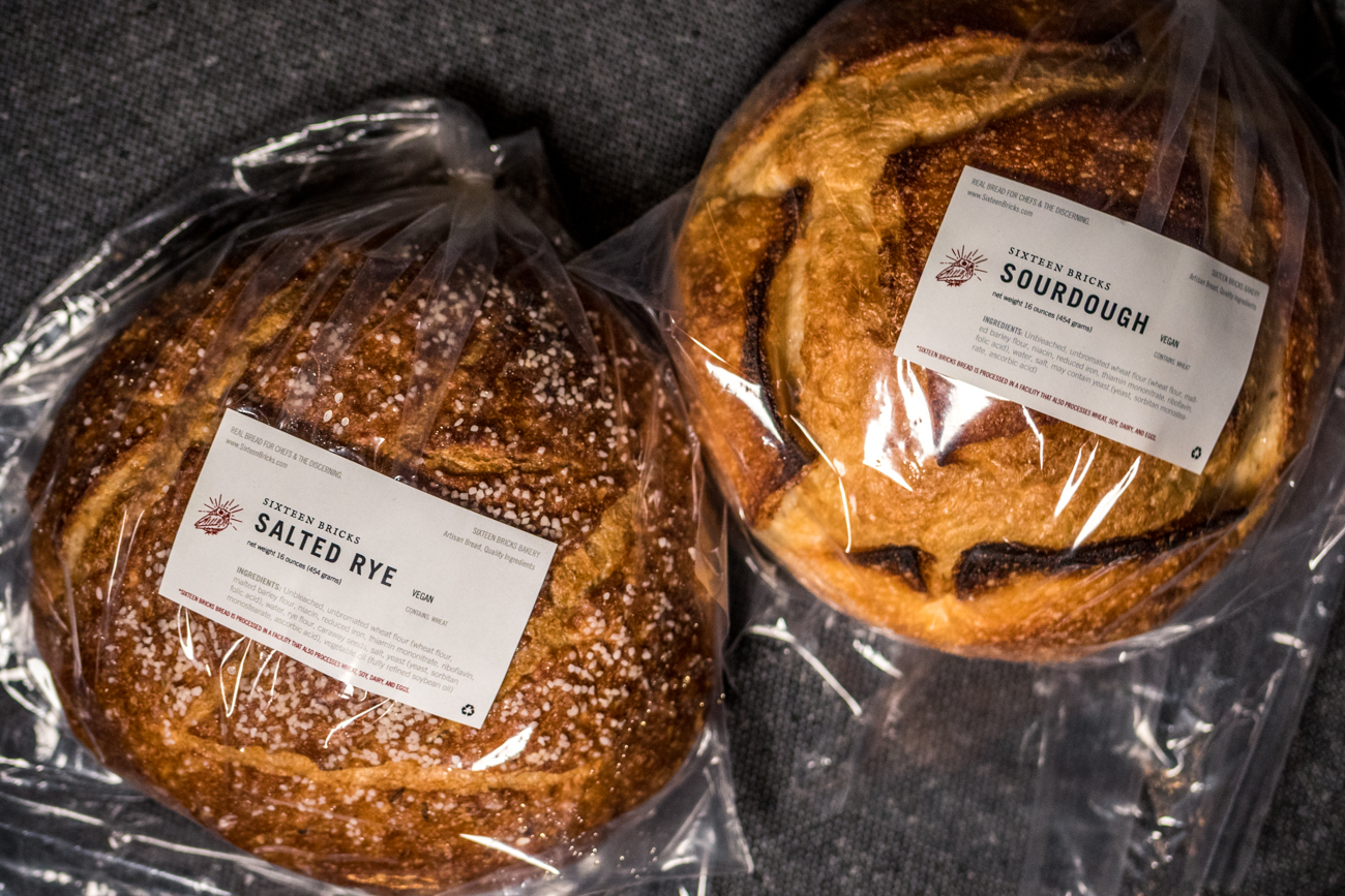 Loaves of 16 Bricks bread included with the Lonely Pine Steakhouse dinner kits to go / Image: Catherine Viox{ }// Published: 6.2.20