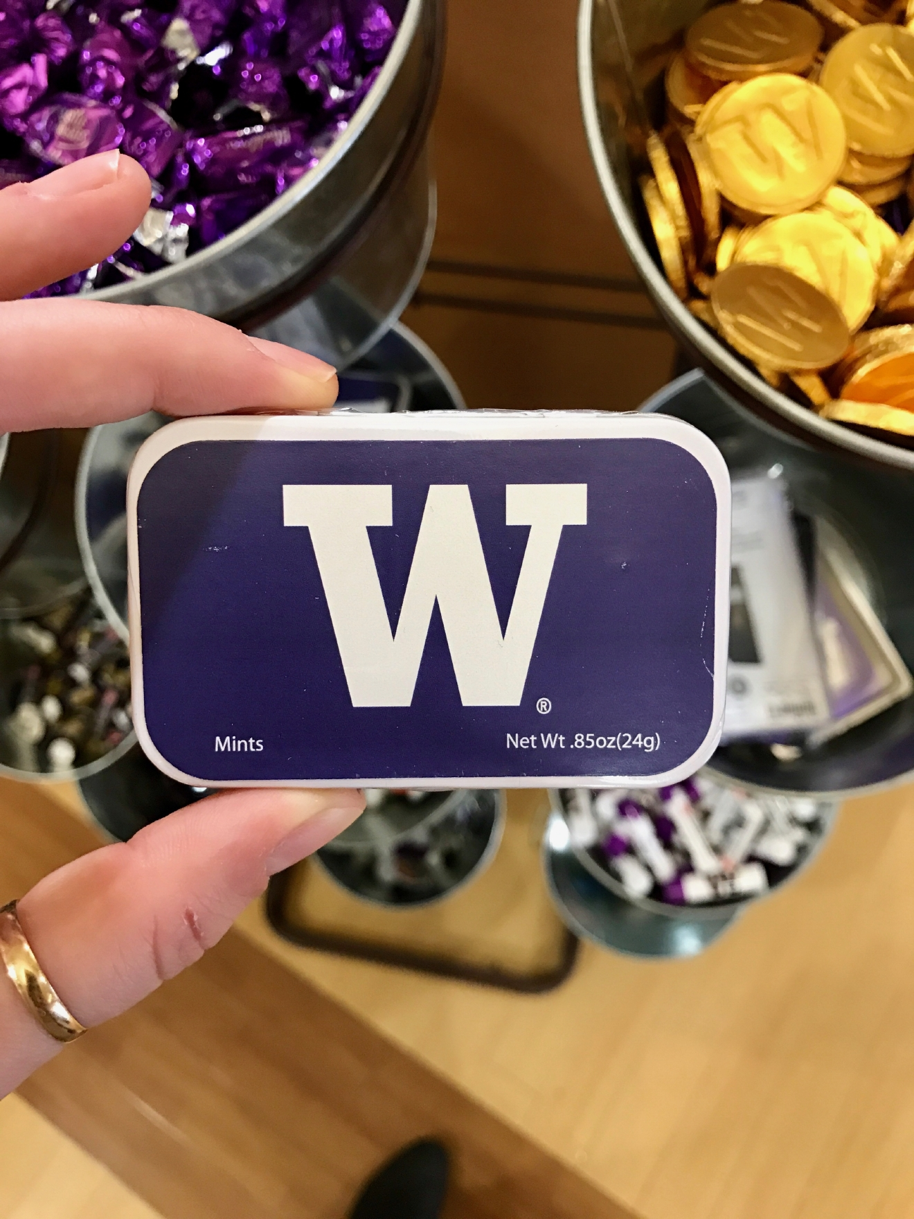 UW Mints - $3.95                                          Whether you're a current student, alum, or just *love* the Dawgs, it's a pretty exciting time to be a Husky fan right now. Just to catch you up, the University of Washington football team is having one of their best seasons in years, and will be playing the Peach Bowl in Atlanta on December 31st. If you know a Dawg fan, they're probably salivating at the mouth right about now. Which is why it's a perfect time to give them a themed gift! Here are some of the coolest Husky gear we saw at the University Bookstore on the Avenue during our last visit. Pro Tip: They're open 10 a.m. - 7 p.m. on Christmas Eve! (Image: Britt Thorson / Seattle Refined)