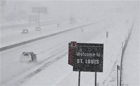Few cars drive on Interstate 44 in Fenton, Mo., Sunday, Jan. 5, 2014. Snow-covered roads and high winds were creating dangerous driving conditions from Missouri to Delaware on Sunday.