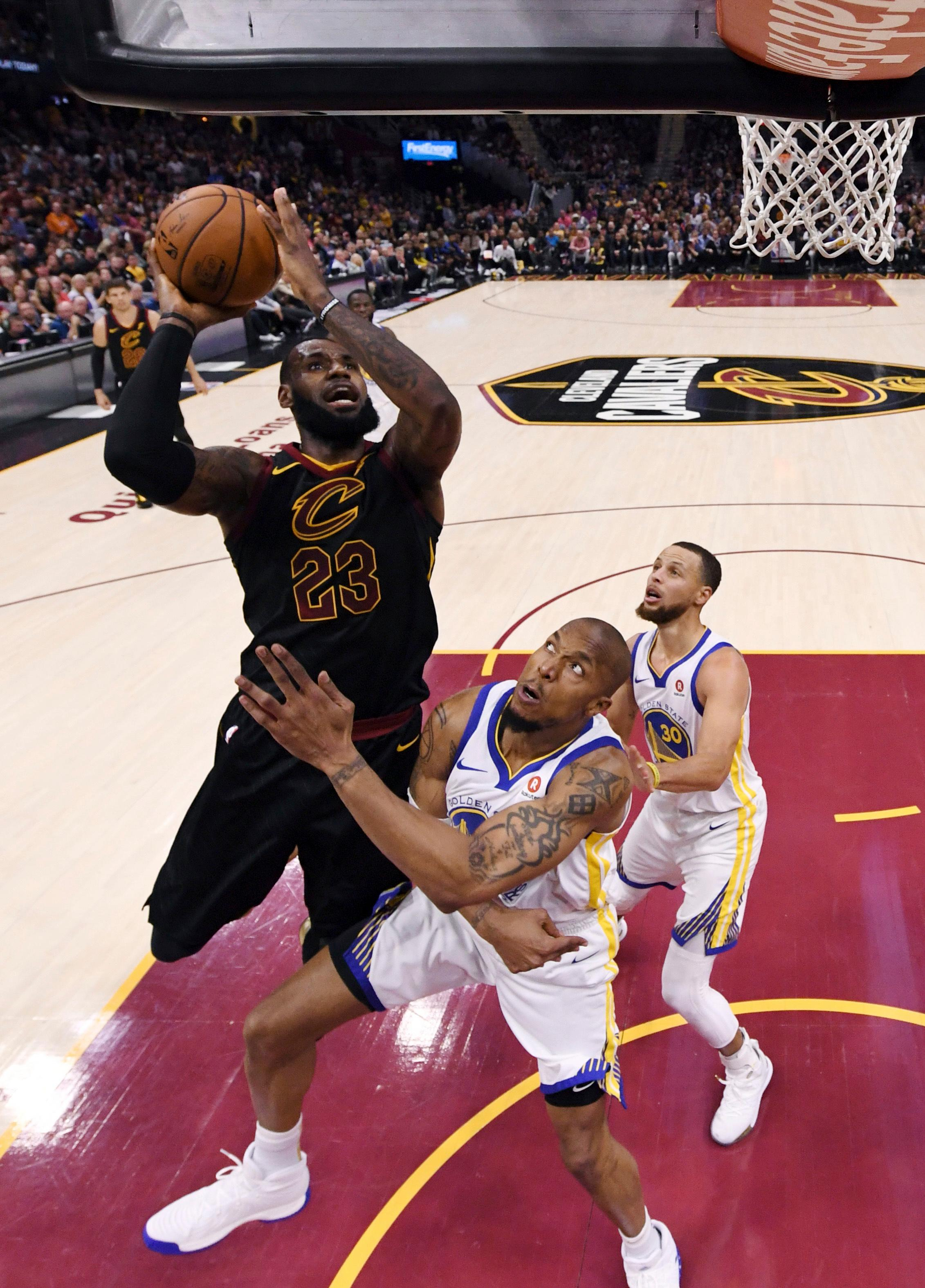 Cleveland Cavaliers' LeBron James shoots over Golden State Warriors' David West during the first half of Game 4 of basketball's NBA Finals, Friday, June 8, 2018, in Cleveland. (Gregory Shamus/Pool Photo via AP)