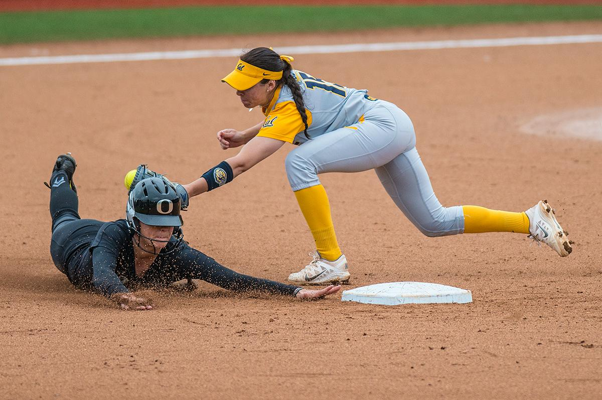 Oregon Ducks Nikki Adria (#3) slides into second base as Cal Bears Lindsay Rood (#15) attempts to get her out. The Oregon Ducks defeated the Cal Bears 2-1 in game two of a three-game series. Photo by Rhianna Gelhart, Oregon News Lab