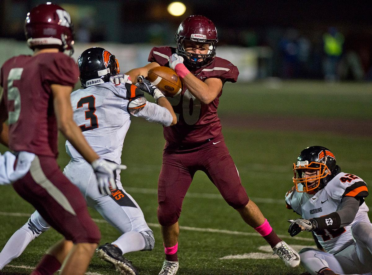 Roseburg Indians defensive back Brendan Ibarra (#3) and Willamette Wolverines running back Tanner Webb fight over a loose ball. Roseburg defeated Willamette 21-20 at Wolverine Stadium. Photo by Dan Morrison, Oregon News Lab