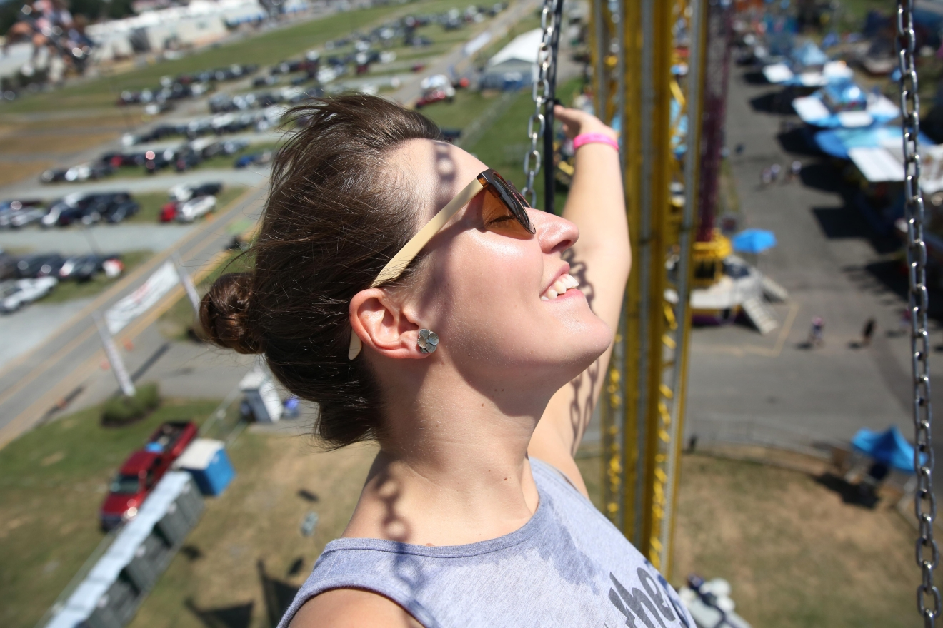 Sarah Kollar enjoys the view from a carnival ride. (Amanda Andrade-Rhoades/DC Refined)