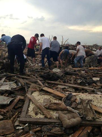 In the hours and days after the tornado, rescuers rushed in to help save whatever was salvagable.