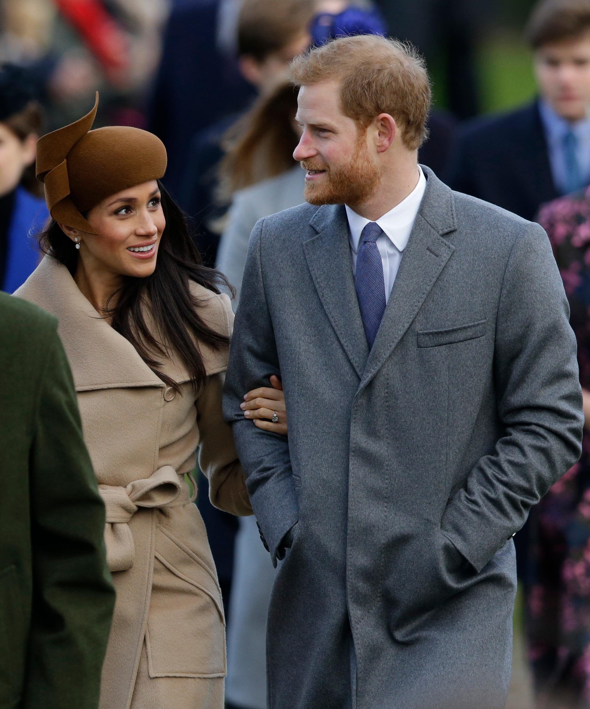 Prince Harry and his fiancee Meghan Markle arrive to their traditional Christmas Day service, at St. Mary Magdalene Church in Sandringham, England, Monday, Dec. 25, 2017. (AP Photo/Alastair Grant)