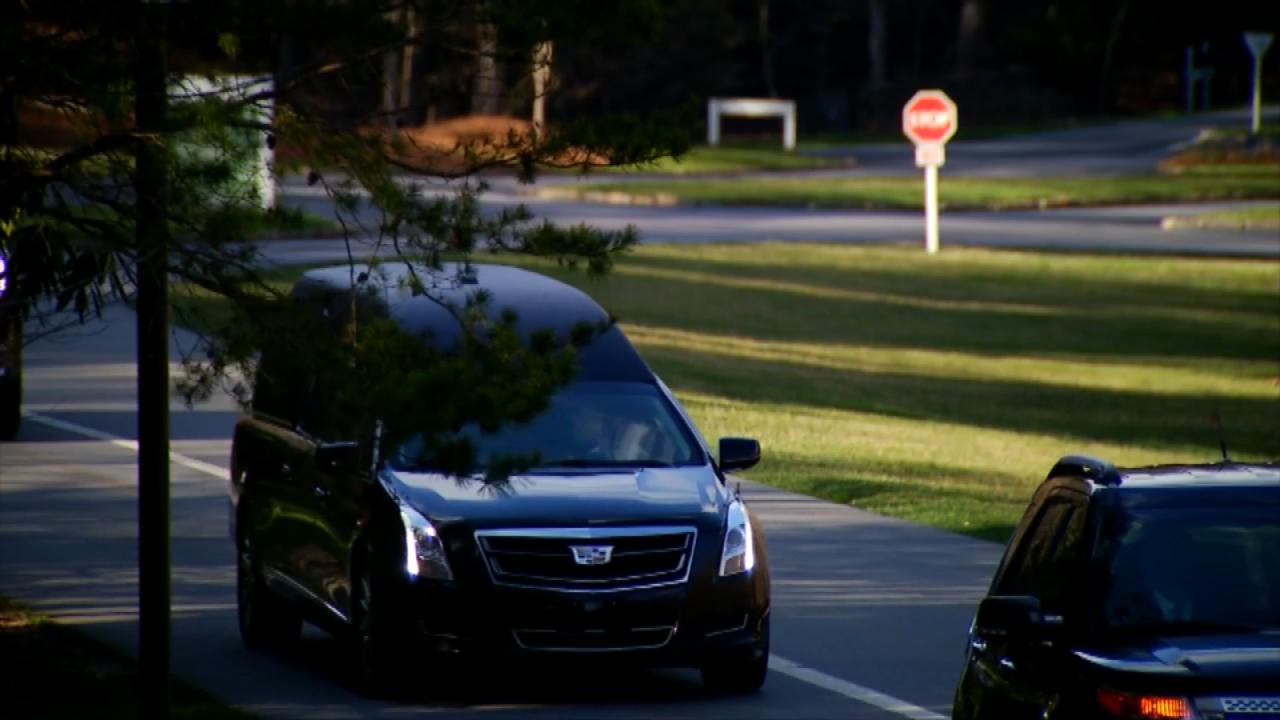 <p>A hearse transporting Billy Graham's casket arrives at The Cove on Thursday, where family will hold a private service. (Photo credit: WLOS Staff)</p>