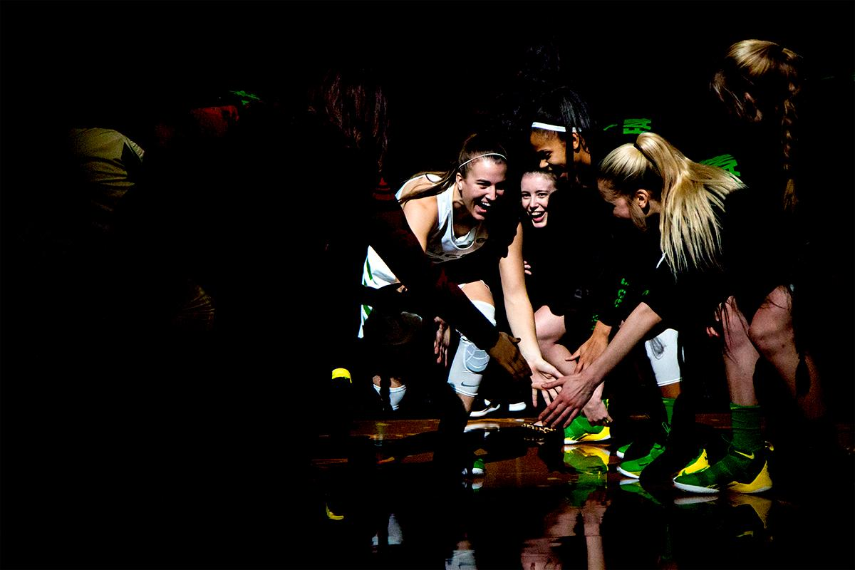 The Duck's Sabrina Ionescu (#20) makes her entrance into Matthew Knight Arena. The University of Oregon Ducks women basketball team defeated the Southern Utah Thunderbirds 98-38 in Matthew Knight Arena Saturday afternoon. The Ducks had four players in double-digits: Ruthy Hebard with 13; Mallory McGwire with 10; Lexi Bando with 17 which included four three-pointers; and Sabrina Ionescu with 16 points. The Ducks overwhelmed the Thunderbirds, shooting 50% in field goals to South Utah's 26.8%, 53.8% in three-pointers to 12.5%, and 85.7% in free throws to 50%. The Ducks, with an overall record of 8-1, and coming into this game ranked 9th, will play their next home game against Ole Miss on December 17. Photo by August Frank, Oregon News Lab