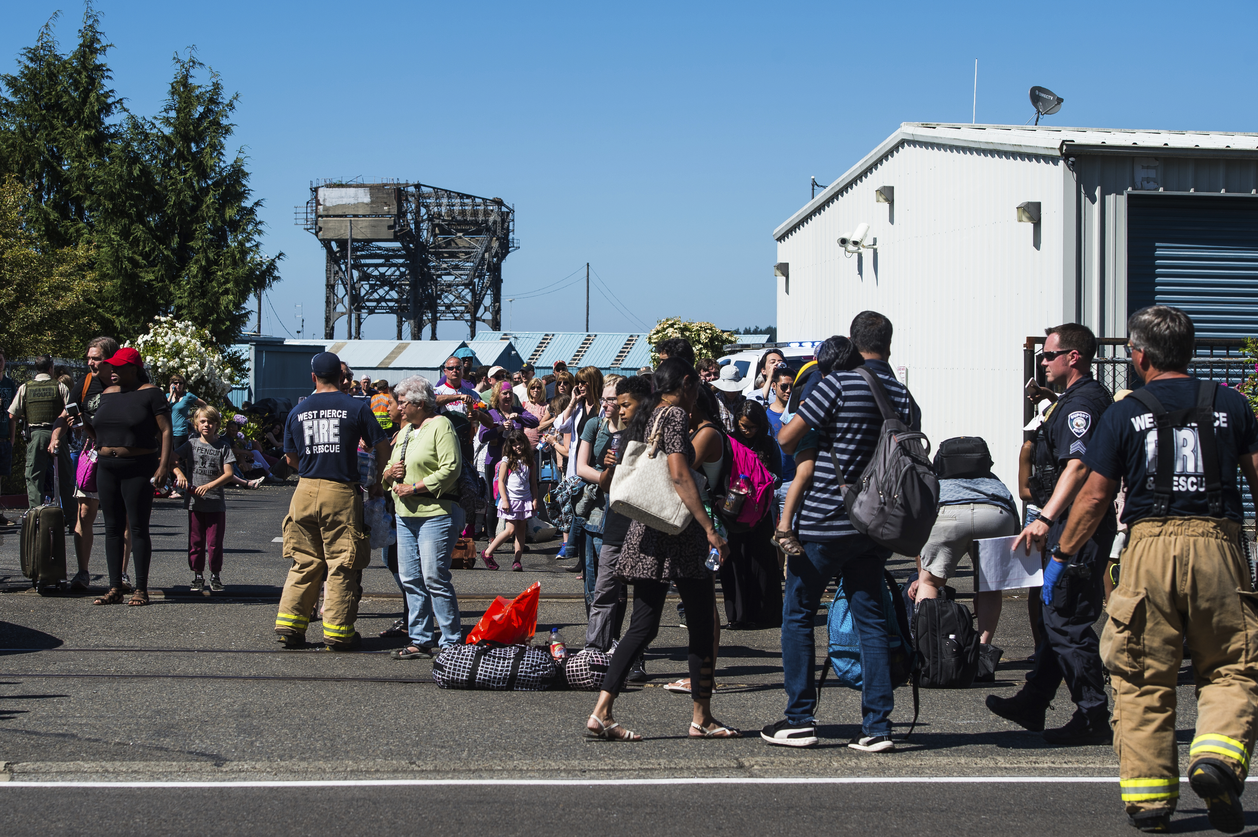Passengers board busses after a train derailment near Chambers Bay on Sunday, July 2, 2017, in Tacoma, Wash. There appear to be only minor injuries from the waterfront derailment of the Amtrak Cascades train near the town of Steilacoom, the Pierce County Sheriff's Office said on Twitter. The train runs between Vancouver, Canada, and Eugene-Springfield, Oregon. (Joshua Bessex/The News Tribune via AP)