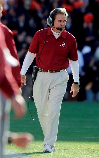 Alabama head coach Nick Saban watches from the sidelines during the first half of an NCAA college football game against Auburn in Auburn, Ala., Saturday, Nov. 30, 2013. (AP Photo/Dave Martin)