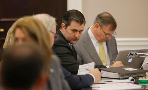 Former North Charleston Police Officer Michael Slager, second from right, sits at the defense table and listens to his lawyer in the courtroom, Thursday, Nov. 3, 2016 in Charleston, S.C. (Grace Beahm/Post and Courier via AP, Pool, File)