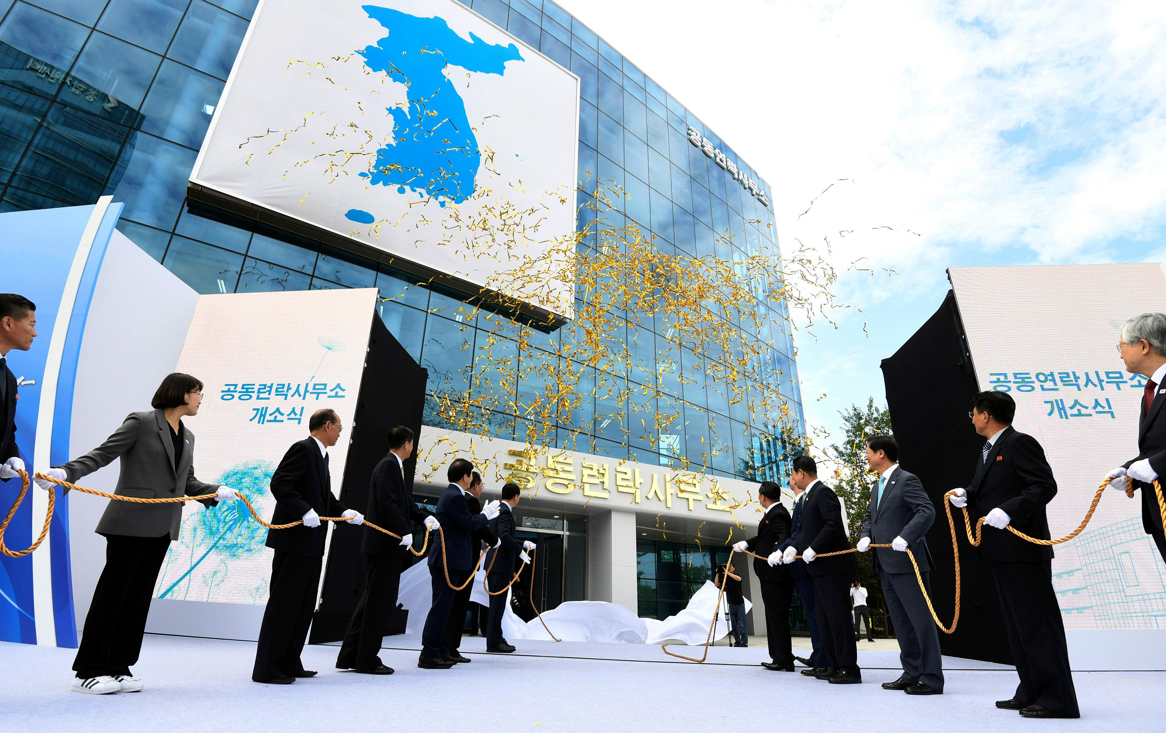 FILE - In this Sept. 14, 2018, file photo, South Korea's Unification Minister Cho Myoung-gyon, center left, and Ri Son Gwon, chairman of the North's Committee for the Peaceful Reunification, center right, attend at an opening ceremony for two Koreas' first liaison office in Kaesong, North Korea. (Korea Pool/Yonhap via AP, File)
