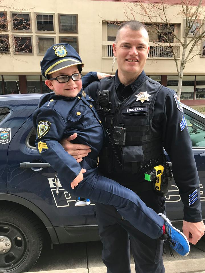 Camden McGee, standing 44.5 inches tall, was out 'patrolling,' as his step dad reports he does most Saturdays or Sundays. He rides the bus to his patrol beat and his passion is to catch bad guys or gals and to help people. He's got public service in his heart as well as some pretty snazzy stripes on his sleeve.
