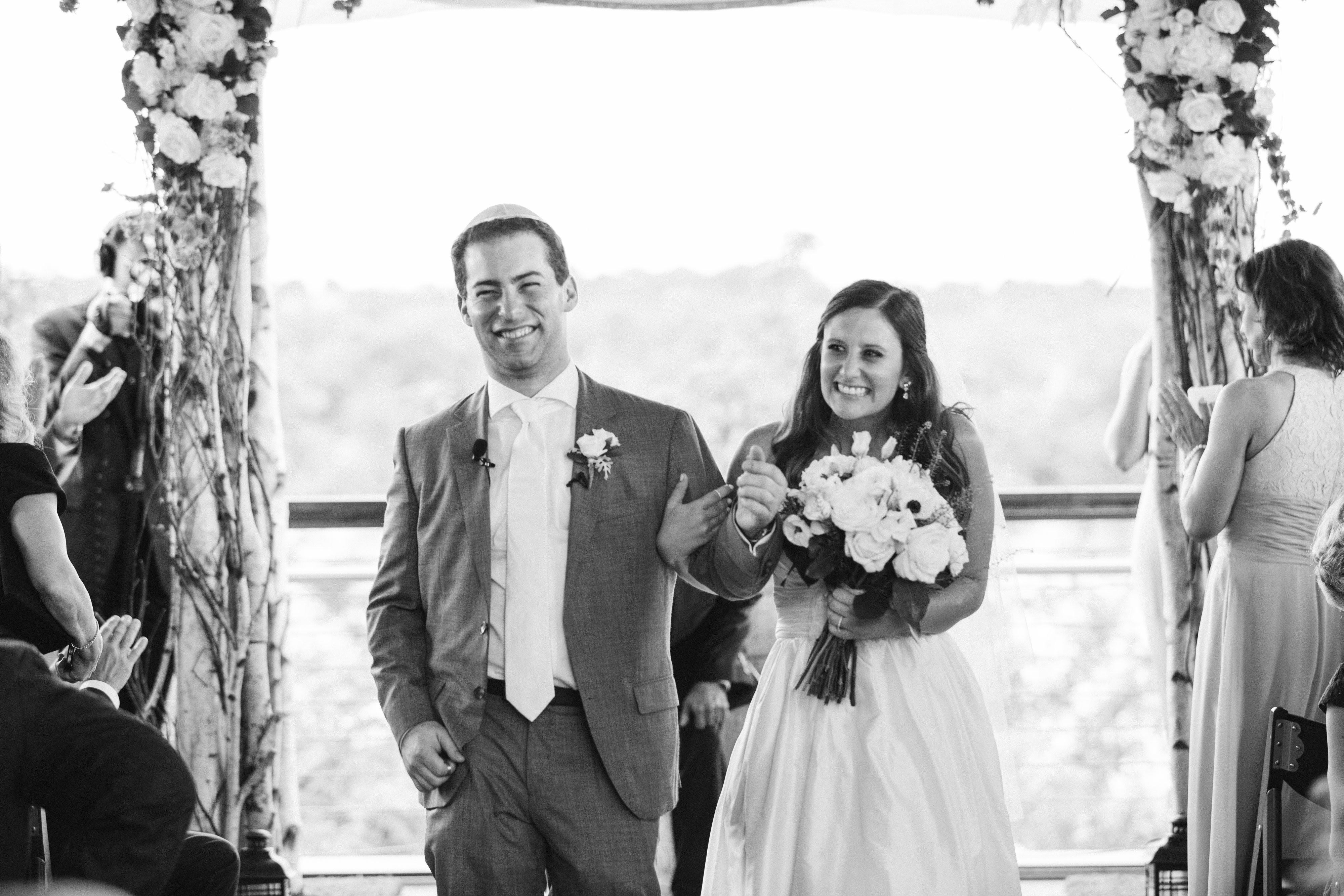 """We cut back on the flowers because we felt that the venue was gorgeous on its own, and that's something that adds up quickly,"" said Melissa. (Image: Birds of a Feather Photography/{ }http://birdsofafeatherphotos.com){ }"
