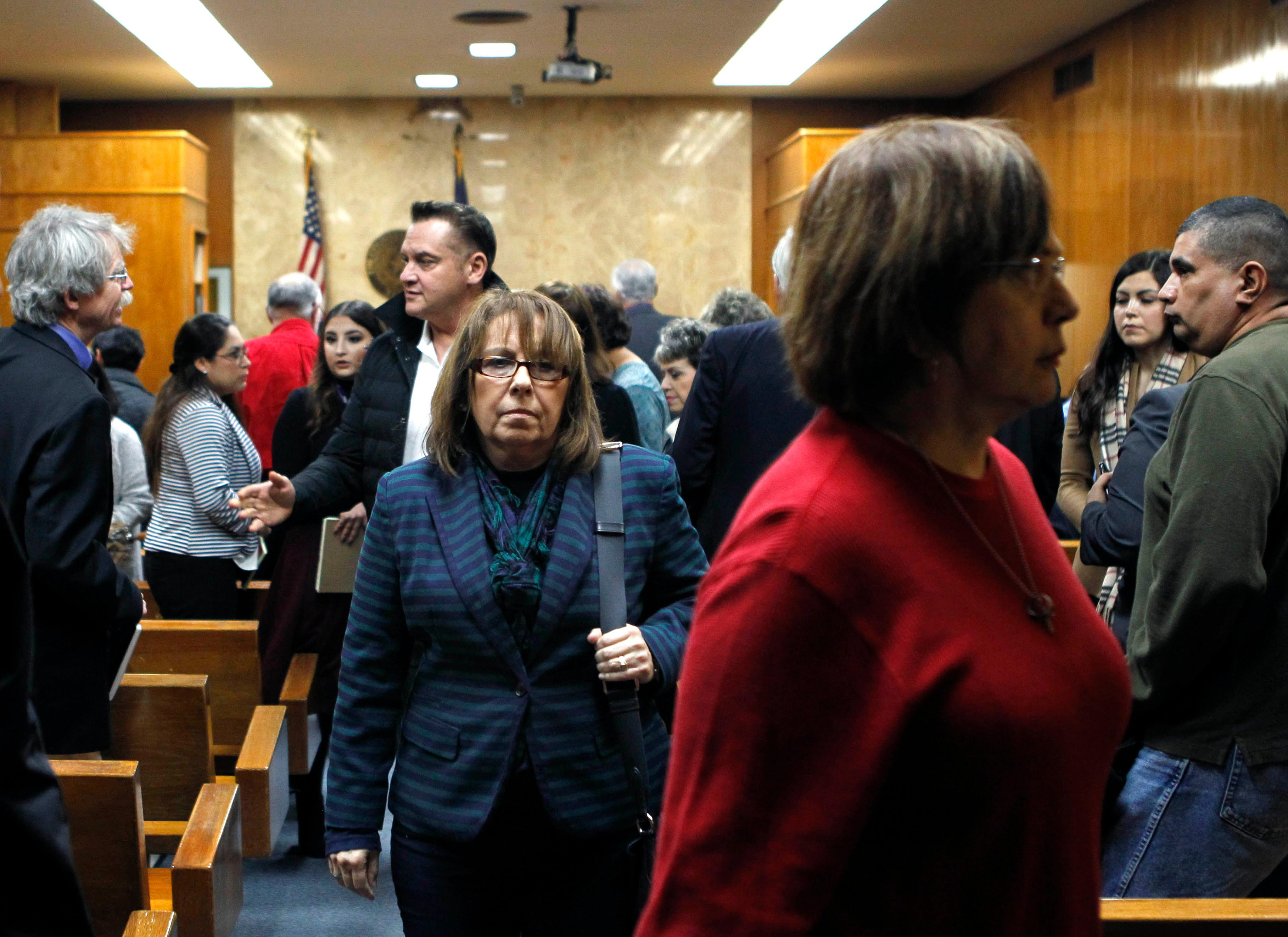 Lynda de la Vi?a, center, extended family member of Irene Garza, walks out of the 92nd state District Court during a break in Feit's trial for the 1960 murder of Garza Wednesday, December 6, 2017, at the Hidalgo County Courthouse in Edinburg. (Nathan Lambrecht/The Monitor/Pool)
