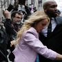 Stormy Daniels stumbles as she enters courthouse for hearing