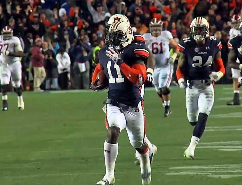 Auburn cornerback Chris Davis (11) returns a missed field-goal attempt 100-plus yards to score the game-winning touchdown as time expired in the fourth quarter of an NCAA college football game against No. 1 Alabama.