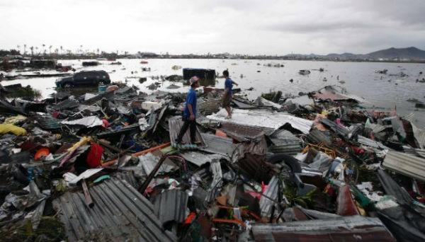 Two boys inspect debris in Tacloban.