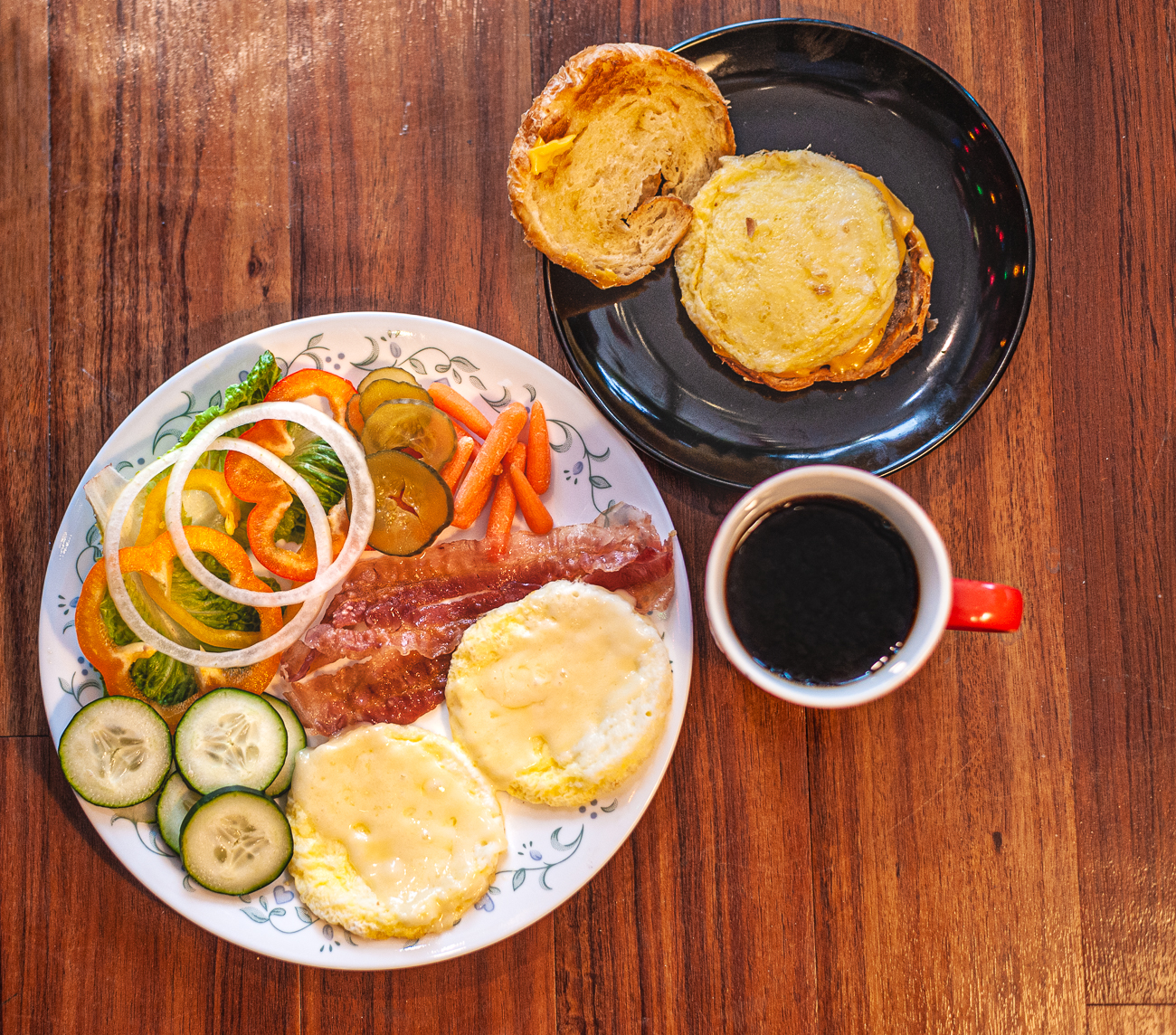 Breakfast Plate, black coffee, and breakfast sandwich{ }/ Image: Kellie Coleman // Published: 1.31.21