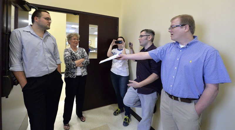 File - In this Aug. 13, 2015, file photo, David Ermold, right, as he attempts to hand Rowan County clerks Nathan Davis, left, and Roberta Earley, second from left, a copy of the ruling from U.S. District Court Judge David Bunning, instructing the county to start issuing marriage licences in Morehead, Ky. Ermold filed to run for county clerk on Dec. 6., 2017 hoping to challenge Kim Davis, who to years ago told him &quot;God's authority&quot; prohibited her from complying with a U.S. Supreme Court decision that effectively legalized gay marriage nationwide (AP Photo/Timothy D. Easley, File)<p></p>