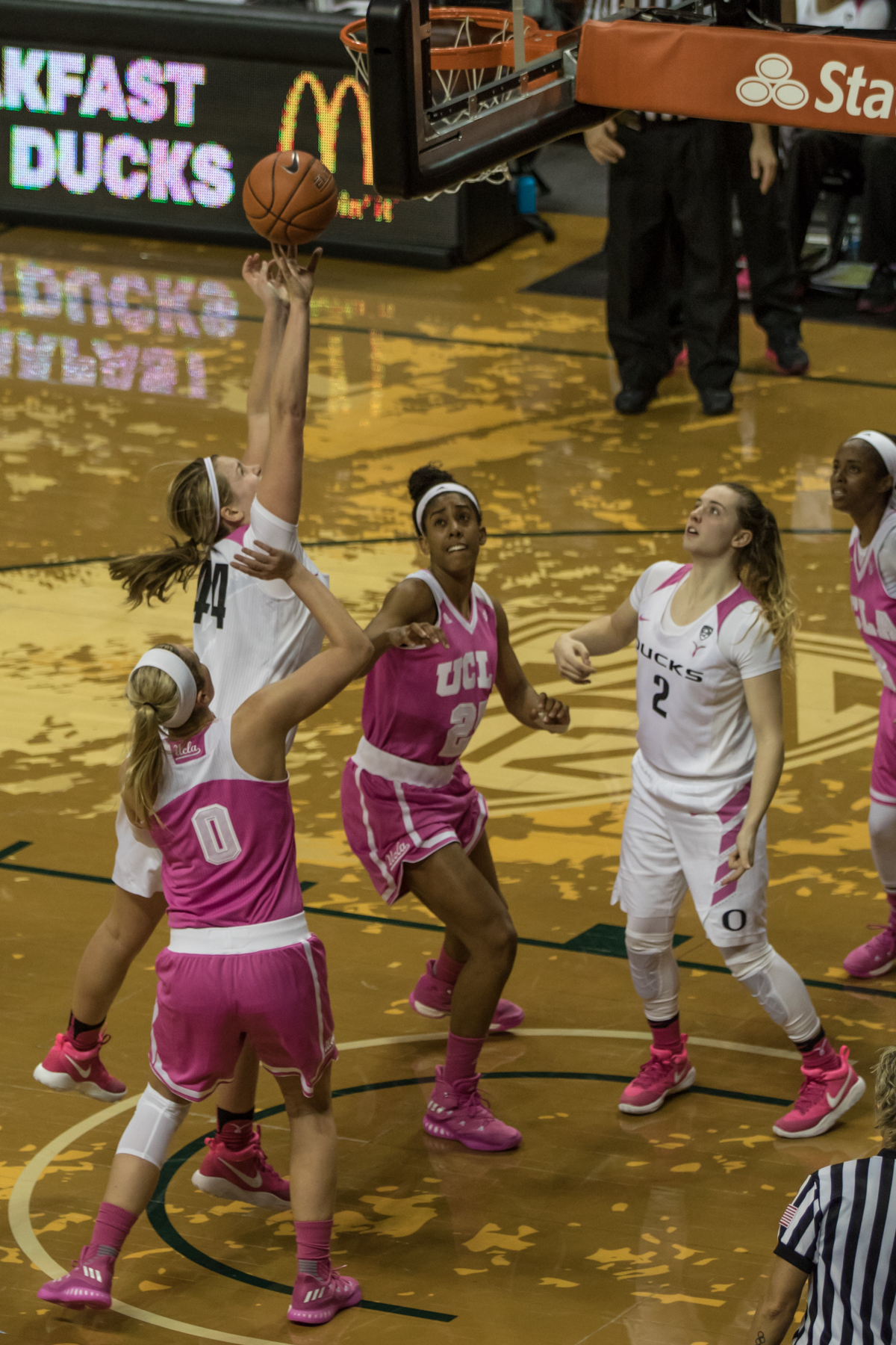 Oregon Ducks forward Mallory McGwire (#44) shoots over UCLA Bruins defenders Nicole Kornet (#0) and Monique Billings (#25). The Oregon Ducks defeated the No. 15 UCLA Bruins 84-75 Friday evening at Matthew Knight Arena in Eugene, Oregon.  Photo by Austin Hicks, Oregon News Lab