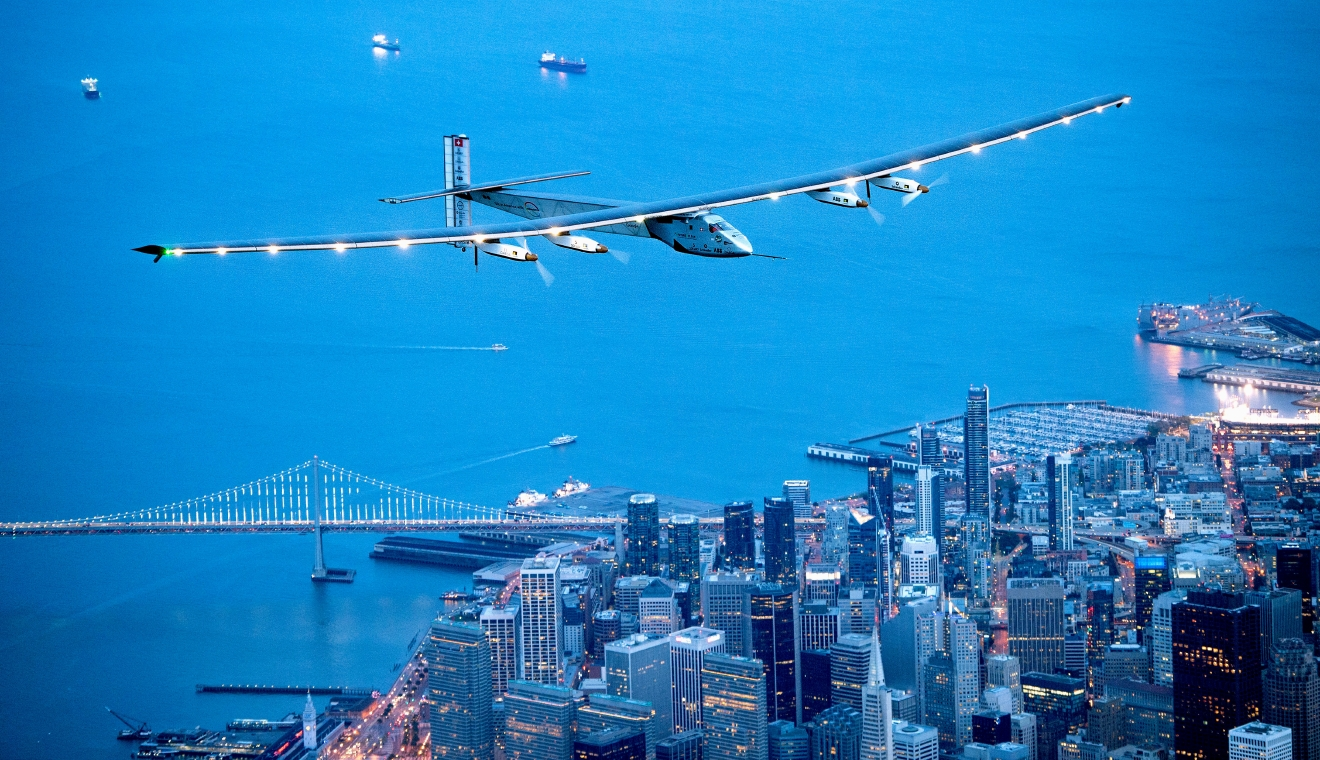 Solar Impulse 2 flies over San Francisco on Saturday, April 23, 2016. The solar-powered airplane, which is attempting to circumnavigate the globe to promote clean energy and the spirit of innovation, arrived from Hawaii after a three-day journey across the Pacific Ocean. (AP Photo/Noah Berger)