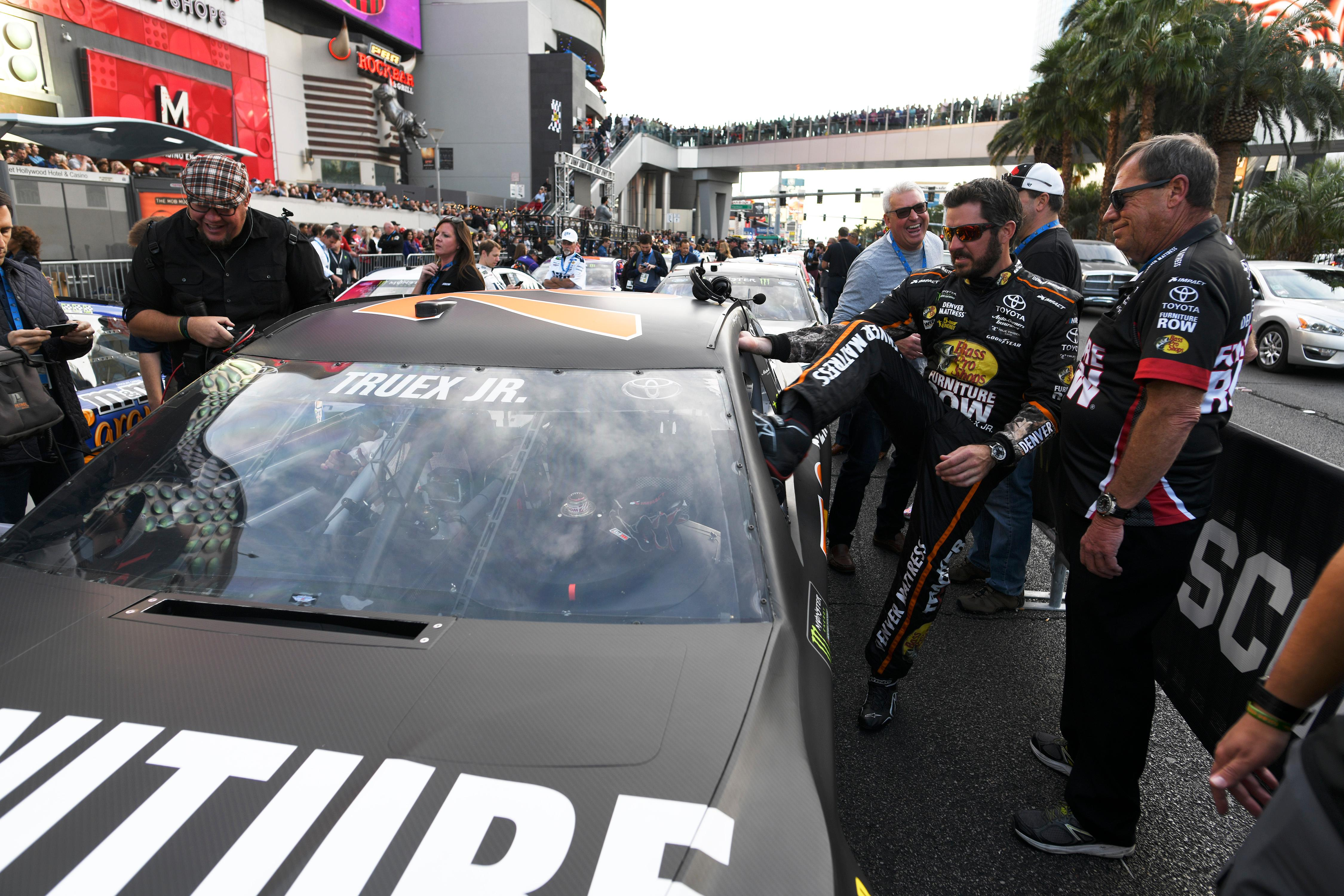 Monster Energy NASCAR Cup Series driver Martin Truex Jr. hops into his car during the NASCAR Victory Lap on the Las Vegas Strip being held as part of Champions Week Wednesday, November 29, 2017. CREDIT: Sam Morris/Las Vegas News Bureau